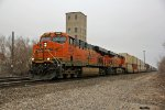 BNSF 7854 Heads up a long stack train WB.