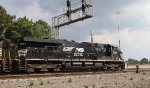 NS 7643 passes under the signals at Eleventh Street