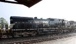 NS 8775 rolls by in a brief afternoon thundershower