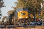 SD70MAC 4759 leads southbound intermodal L031 through the fall colors in town in late afternoon
