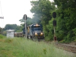 "Westbound ballast train, with a BBH crew eon board, rolls westward through the signals at ""Easton"", MP 219"