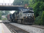 A northbound manifest rolls across the C&O diamonds and through the station on track 2
