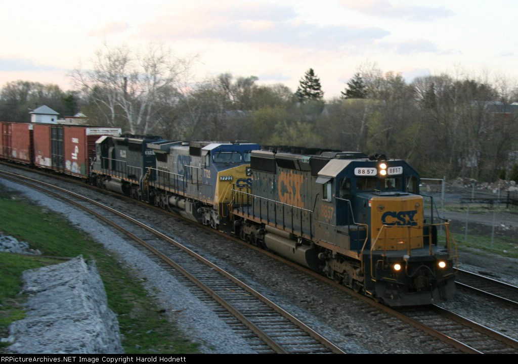 CSX 8857 leads train Q370 eastbound late in the the evening