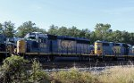 CSX 8218 sits in the dead line with other locos