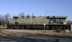 Southbound CSX freight with primer NS GEVO