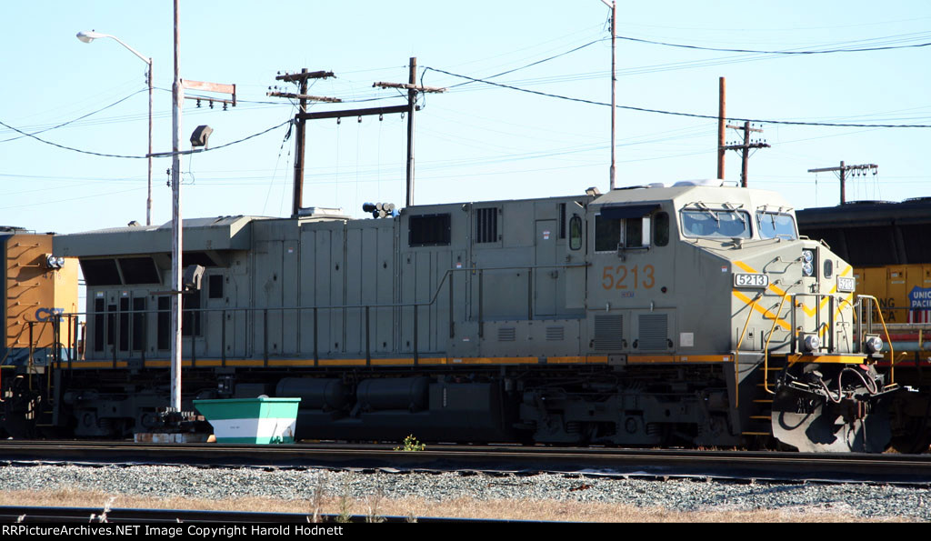 CSX 5213 as delivered in primer, at the fuel racks