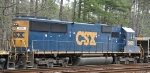 CSX 2495 sits in a siding with a work train