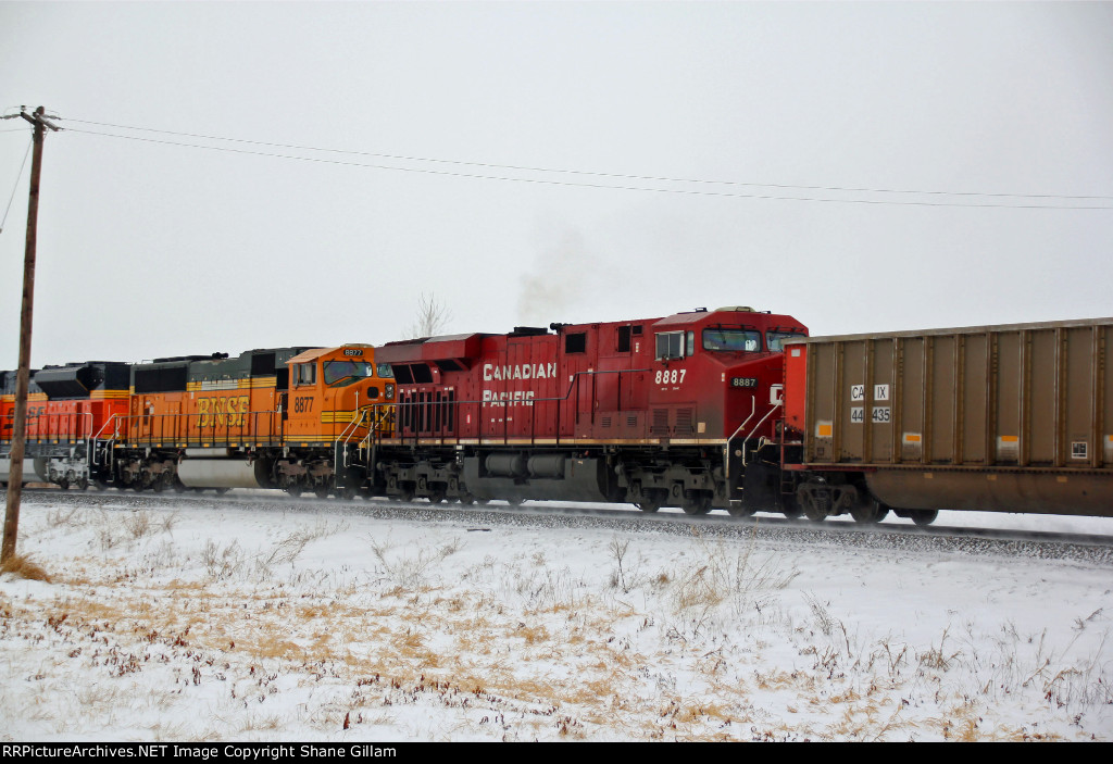 CP 8887 trails 3rd out on a empty coal.