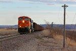 BNSF 6135 Heads up a empty ore train.