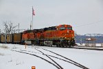 BNSF 6246 Rolls past river front.