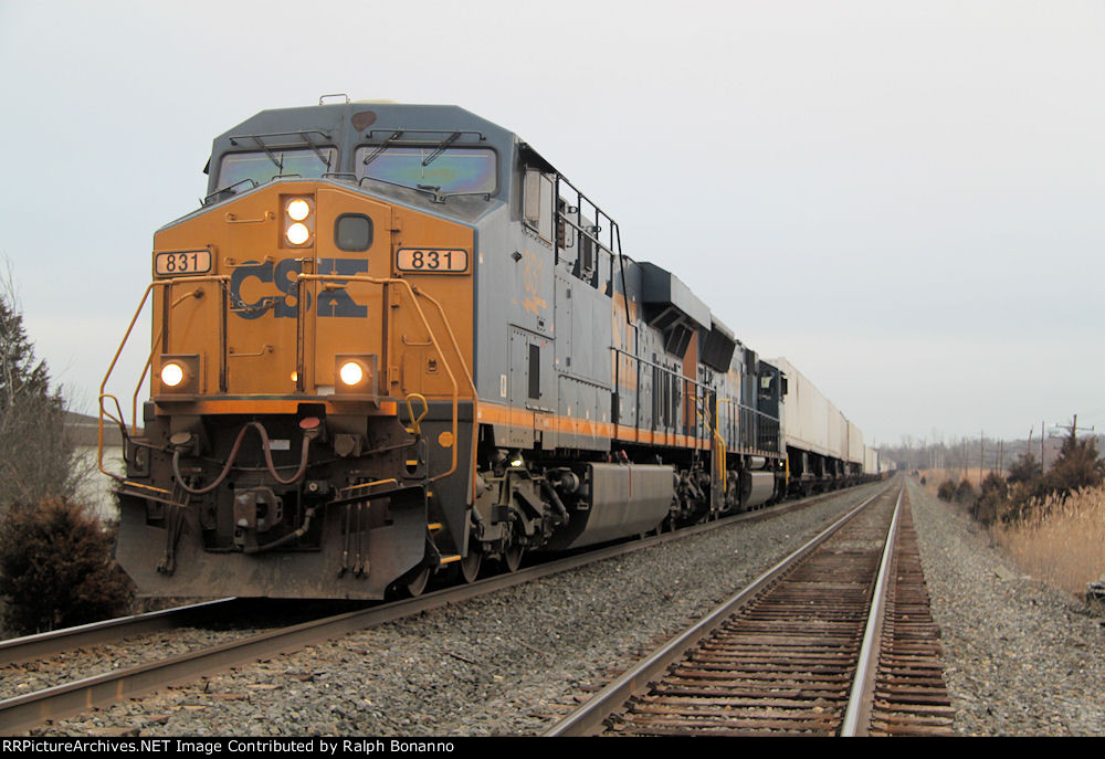 Late running Q010-13 holds the main at CP-118 for a northbound.