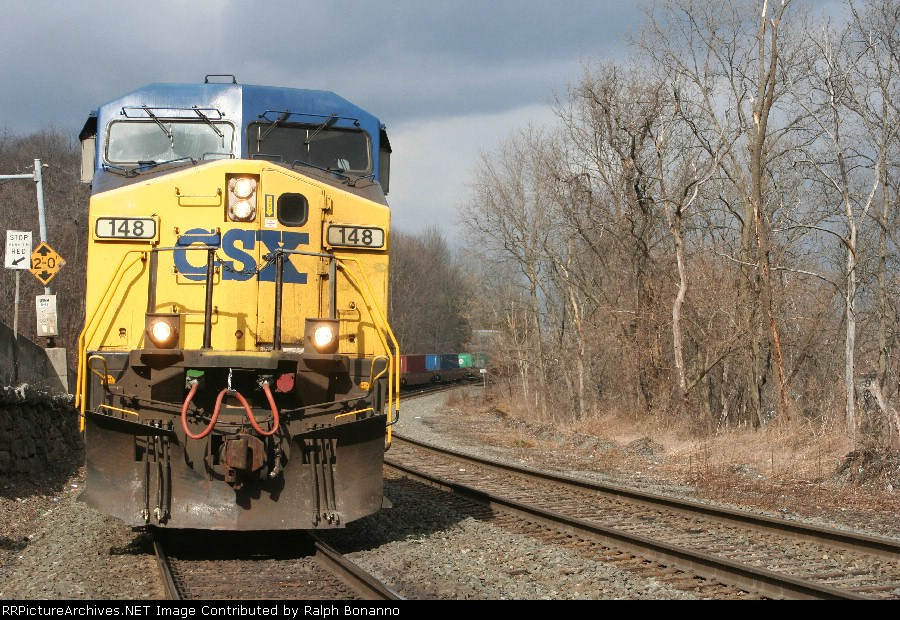 AC44 CW 148 and train Q156-15 hold the main at CP-102 awaiting a northbound
