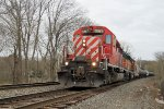 K678-11 with CP and NREX power holds on the siding awaiting northbound traffic on an overcast Saturday morning