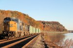 Southbound Q703 takes the siding at CP-69 along the Hudson with fall foliage at/near peak in the background