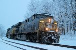 Q008 holds on the siding at CP-78 on the River line as daybreak reveals fresh snow