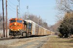 A BNSF GEVo leads southbound Q268 into town today