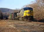 Q439, with an NS trailing uniot rolls southbound in the afternoon sun