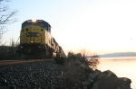 CSX Q703-13 with an Ex Conrail SD60 I leading, pauses along the Hudson at sunrise