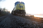 CSX Q703-13  pauses along the Hudson River at sunrise  with traffic stopped ahead of it