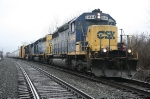 Under dreary skies, Q417-11 holds the siding at Bailey Street with premium CSX power