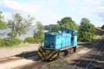 This SW 1500, # 302, is used at the power plant to move loaded and empty coal hoppers