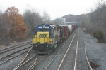 S434-18 awaits a recrew on the siding at the Marquette crossing