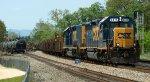 CSX 6415 on the B01406 rail train easing slowly eastward dropping rail at the derailment site