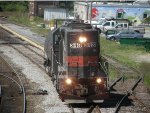 MEC 313 moves east with one tank car in tow