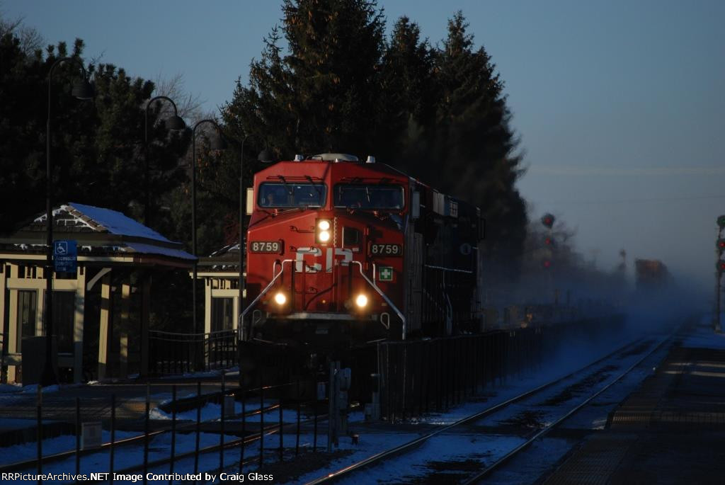 CP 8759 leads a freight southbound towards Chicago