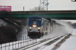 AMTK 174 heads a Superliner under a bridge, northbound out of Chicago