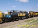 Tank car on Loram RG 319