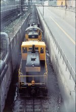 Eastman Kodak #6 (80 Ton) and #9 (RS-1) shoving hard uphill.