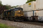 CSX 759 leads the daily Q253, empty autorack north past the former NYC station.