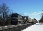NS 9834 leads westbound empty auto racks through Sheridan, PA