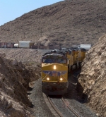 UP 7667 slowly makes it way through the curves at Sloan, NV