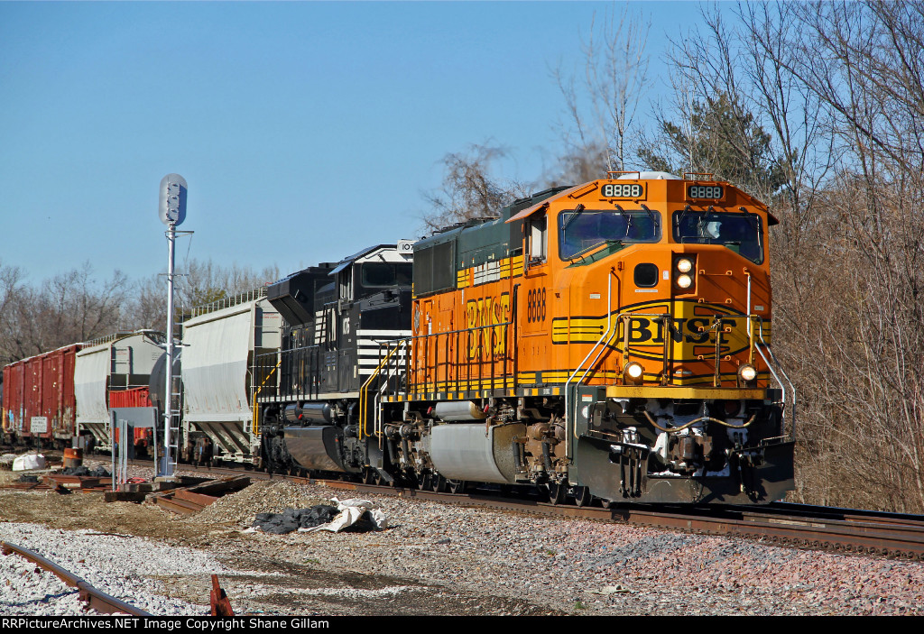 BNSF 8888 and NS 1076 lead this freight SB.