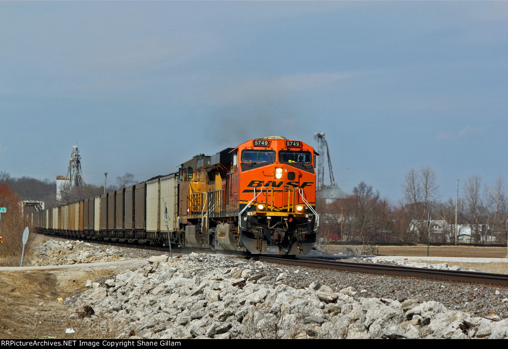 BNSF 5749 leads the C WTMSKS down the K line.
