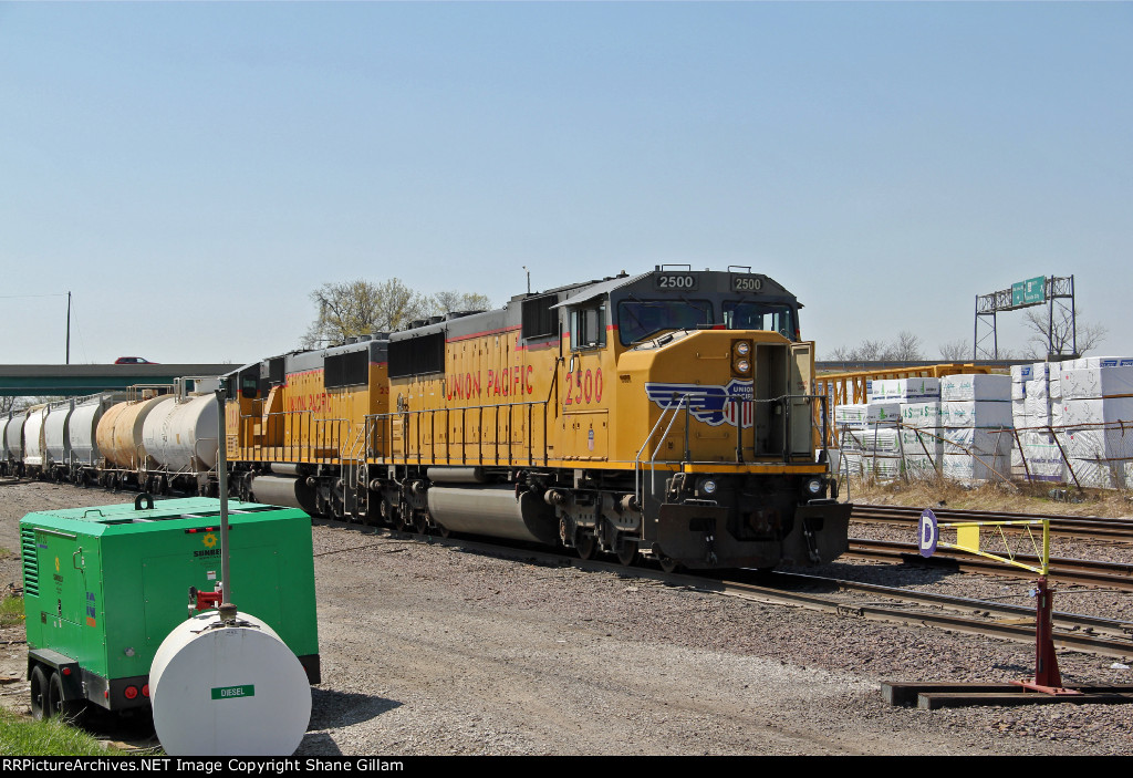 2 UP SD60M's lead this freight train..