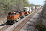 BNSF 7236 Heads down hill with a stack train in tow..