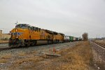 UP 7975 Heads up a small Z train up the Kcs line.