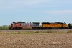 BNSF 913 And NREX 5952 lead a freight train East..