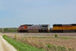 BNSF 913 Screams East with a freight train..