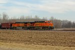 BNSF 6047 Heads up a loaded Oil can.