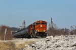 BNSF 6711 Heads up a loaded Hayti Oil can.
