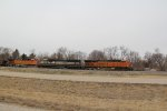 BNSF 7352 Leads a empty ore train up the High speed main.