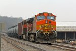 BNSF 4940 Sits tied down on a loaded oil can.
