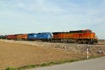 BNSF 5512 leads a empty oil can with Cefx 90Mac..