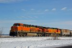 BNSF 7164 Leads the NSLWQM up the K line.