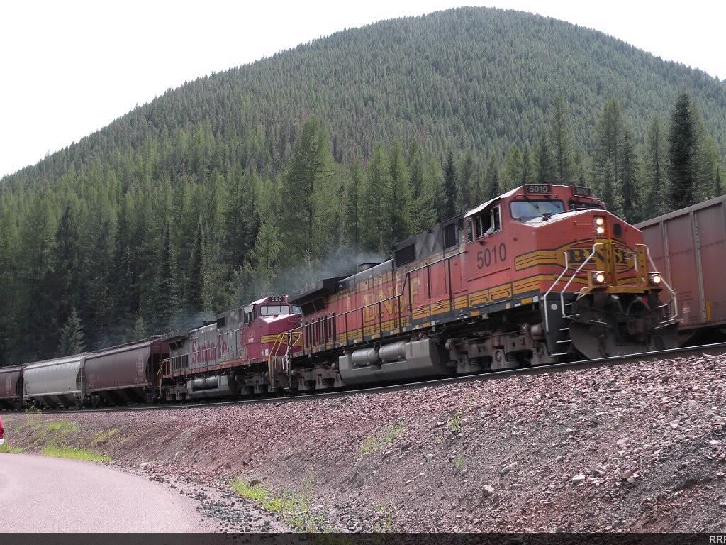 The third covered hopper train in a row passes the empty coal train in the hole.