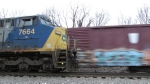 CSX 7664 stopped with a full load and another train passes with an old CR boxcar